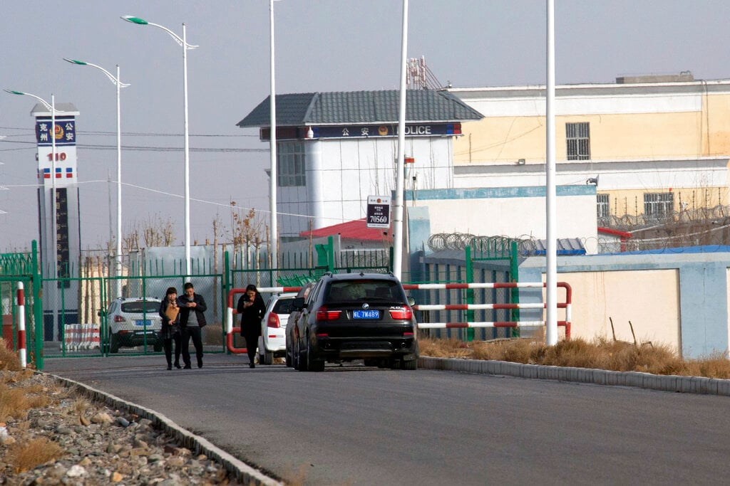 """FILE.- In this Dec. 3, 2018, file photo, a police station is seen by the front gate of the Artux City Vocational Skills Education Training Service Center in Artux in western China's Xinjiang region. Confidential documents, leaked to a consortium of news organizations, lay out the Chinese government's deliberate strategy to lock up ethnic minorities to rewire their thoughts and the language they speak. One of the documents says that internment camps – such as the one in Artux – are to install police stations at gates, as well as other security measures to """"prevent escapes"""". (AP Photo/File)"""