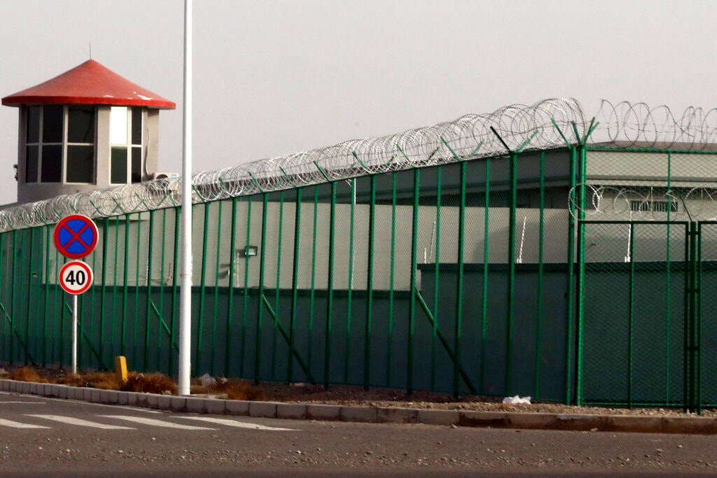 """FILE.- In this Monday, Dec. 3, 2018, file photo, a guard tower and barbed wire fences are seen around a section of the Artux City Vocational Skills Education Training Service Center in Artux in western China's Xinjiang region. This is one of a growing number of internment camps in the Xinjiang region, where by some estimates over 1 million Muslims have been detained, forced to give up their language and their religion and subject to political indoctrination. Confidential documents, leaked to a consortium of news organizations, lay out the Chinese government's deliberate strategy to lock up ethnic minorities to rewire their thoughts and even the language they speak. One of the documents says that internment camps – such as the one in Artux – are to install guard towers, as well as other security measures to """"prevent escapes"""". (AP Photo/File)"""