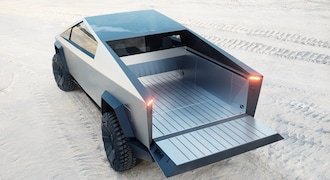 With up to 3,500 pounds of payload capacity and adjustable air suspension, Cybertruck is the most powerful tool we have ever built, engineered with 100 cubic feet of exterior, lockable storage — including a magic tonneau cover that is strong enough to stand on.