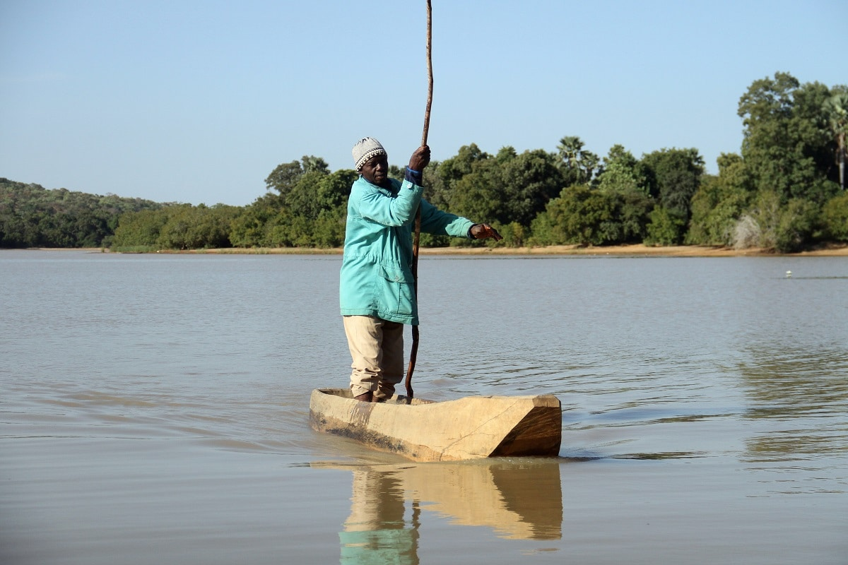Modeste Traore, a 56-year old fisherman, rides his fishing boat in the Lake Wegnia, in Sahel region of Koulikoro. Lake Wegnia, or Lac Wegnia in French, is located in the Sahel region of Koulikoro, around 120 km north of the capital Bamako. Some 12,000 people including fishermen, farmers and herders depend on it for food, water and income, while its freshwaters and marshes also contain rich biodiversity. (REUTERS/Arouna Sissoko)