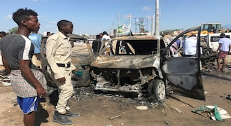 Somali security assess the scene of a car bomb explosion at a checkpoint in Mogadishu, Somalia December 28, 2019. REUTERS/Feisal Omar