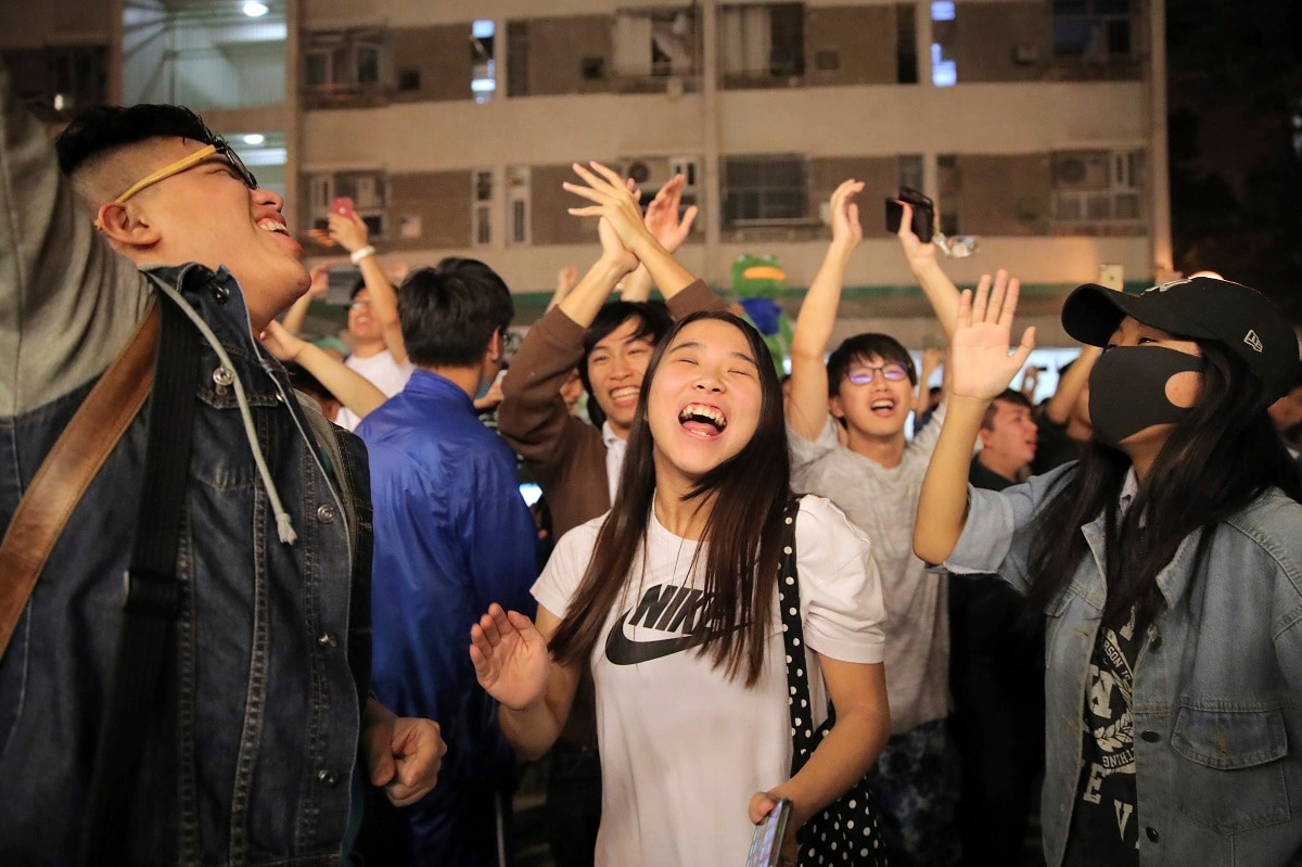 Pro-democracy supporters celebrate after pro-Beijing politician Junius Ho lost his election in Hong Kong. Vote counting was underway in Hong Kong early Monday after a massive turnout in district council elections seen as a barometer of public support for pro-democracy protests that have rocked the semi-autonomous Chinese territory for more than five months. (AP Photo/Kin Cheung, File)