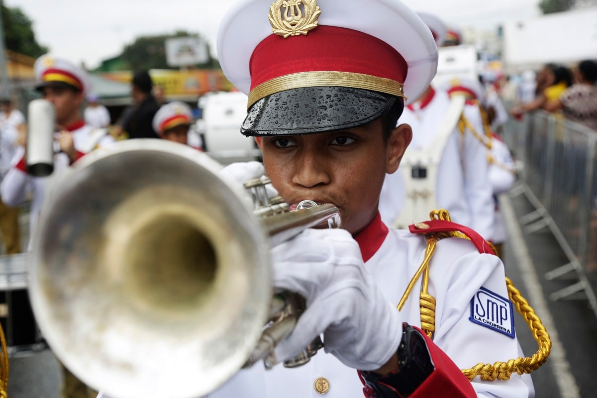A student plays his trumpet during an independence day parade in La Chorrera, Panama. Panama is celebrating 198 years of independence from Spain. (AP Photo/Arnulfo Franco)
