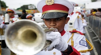 In this Nov. 28, 2019 photo, a student plays his trumpet during an independence day parade in La Chorrera, Panama. Panama is celebrating 198 years of independence from Spain. (AP Photo/Arnulfo Franco)