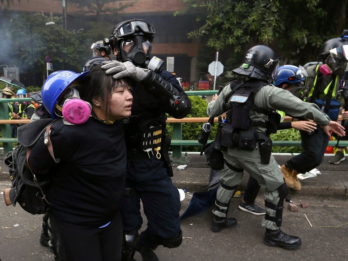 Riot police detain protesters at Hong Kong Polytechnic University in Hong Kong. About 100 anti-government protesters remained holed up at the university Tuesday as a police siege of the campus entered its third day. (AP Photo/Achmad Ibrahim, File)