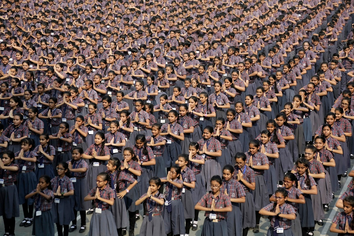 """In this Friday, Nov. 29, 2019, file photo, Indian students dance as part of a """"Save girl, Educate girl"""" initiative and an attempt for a world record, at a school in Ahmadabad, India. More than Six thousand students of a school participated in the group dance, according to a press release. (AP Photo/Ajit Solanki, File)"""