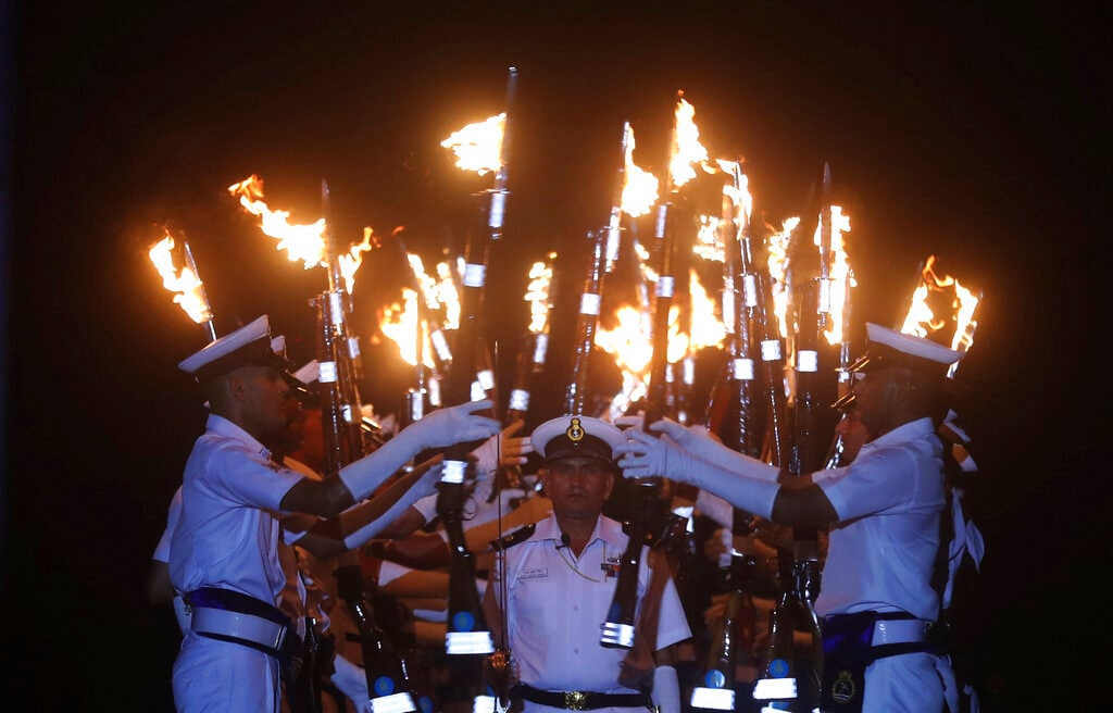 Indian navy personnel display their skills during a rehearsal for Naval Day celebrations in Mumbai, India, Sunday, Dec. 1, 2019. Navy Day will be celebrated on Wednesday. (AP Photo/Rafiq Maqbool)