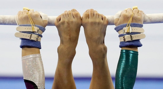 In this Tuesday Dec. 3, 2019, file photo, Vietnam's Ngoc Huong Do Thi performs at the uneven bars during the women's artistic gymnastics competition at the 30th South East Asian Games in Manila, Philippines. (AP Photo/Aaron Favila, File)