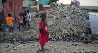 In Pictures: Protests subside, but economic aftershocks rattle Haitians