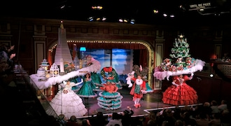 """In this Wednesday, Dec. 4, 2019 photo, performers fill the stage for the final number of the musical """"Beach Blanket Babylon"""" in San Francisco. The campy small San Francisco show that's been a must-see for tourists and locals alike for more than 45 years is closing its curtain. The show, which spoofs politics and pop culture, started in 1974, making it the nation's longest continuously running musical revue. Its final performance is set for New Year's Eve. (AP Photo/Eric Risberg)"""
