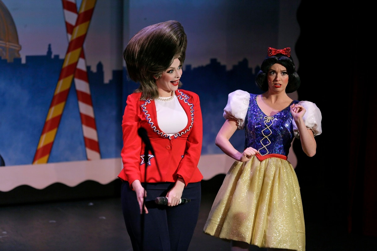 Hillary Clinton and Snow White are portrayed by Jennifer Morrison, left, and Ruby Day, right, during a performance of the musical Beach Blanket Babylon in San Francisco. (AP Photo/Eric Risberg)