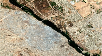 This July 2017 image shows the Old City of Mosul, Iraq, after a punishing nine-month battle to oust Islamic State militants. The Islamic State group emerged in 2014 during chaotic conflicts in Syria and Iraq. The militants seized towns and cities, quickly gaining control of one-third of both countries. IS created what no other extremist group had before: a so-called Islamic caliphate, with the Syrian city of Raqqa as its capital. In response to the threat, a military campaign by a US-led international coalition slowly chipped away at the group's territory. (Satellite image ©2019 Maxar Technologies via AP)