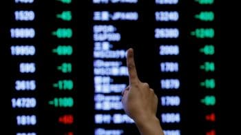 Asian shares adrift as tariff deadline looms