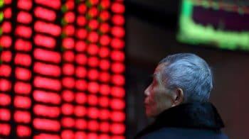 Asian shares edge lower as investors await tariff deadline