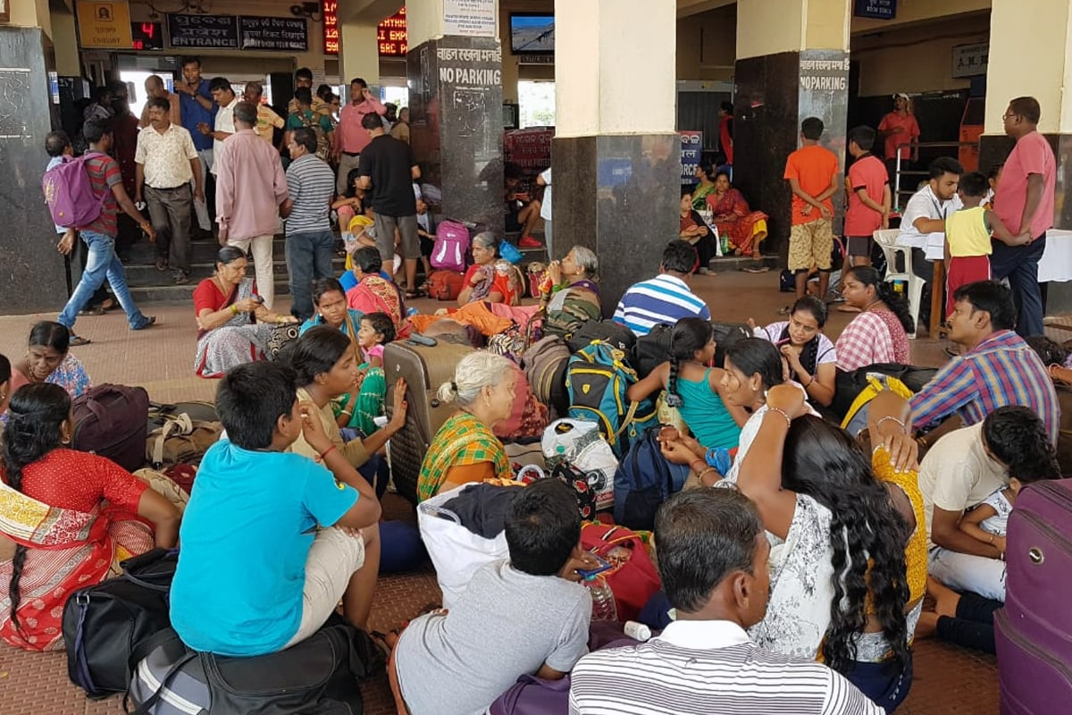 People waiting at Puri railway station to leave the city. 1.2 million people were moved to cyclone shelters in 24 hours before the cyclone made landfall in Puri. Photo by Manish Kumar.