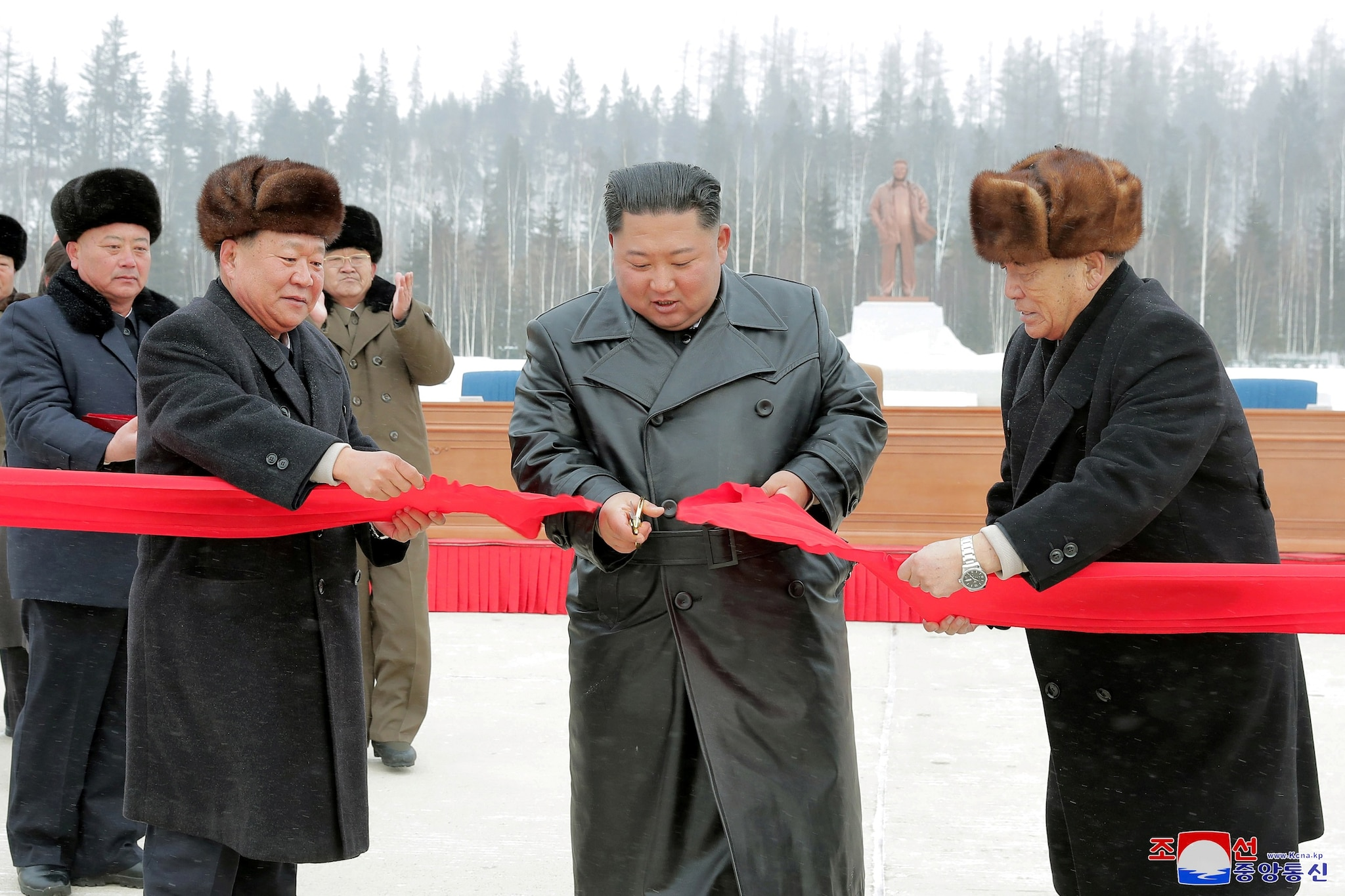 North Korean leader Kim Jong Un accompanied by Pak Pong Ju, vice-chairman of the State Affairs Commission of the DPRK, cuts the ribbon during a ceremony at the township of Samjiyon County, North Korea, in this undated picture released by North Korea's Central News Agency (KCNA) on December 2, 2019. KCNA via REUTERS
