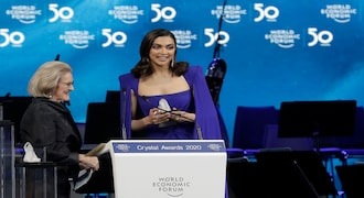 Actress Deepika Padukone, from India, receives a Crystal Award from Hilde Schwab, Chairwoman and Co-Founder of the World Economic Forum's World Arts Forum, during the ceremony for the Crystal Awards at the annual meeting of the World Economic Forumin Davos, Switzerland, Monday, Jan. 20, 2020. The 50th annual meeting of the forum will take place in Davos from Jan. 21 until Jan. 24, 2020. (AP Photo/Markus Schreiber)