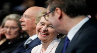 European Commission President Ursula von der Leyen sits between Klaus Schwab, founder and Executive Chairman of the World Economic Forum and Serbia's President Aleksandar Vucic, right, during a celebration of the 50th anniversary of the World Economic Forum in Davos, Switzerland, Monday, Jan. 20, 2020. The 50th annual meeting of the forum will take place in Davos from Jan. 21 until Jan. 24, 2020. (AP Photo/Markus Schreiber)