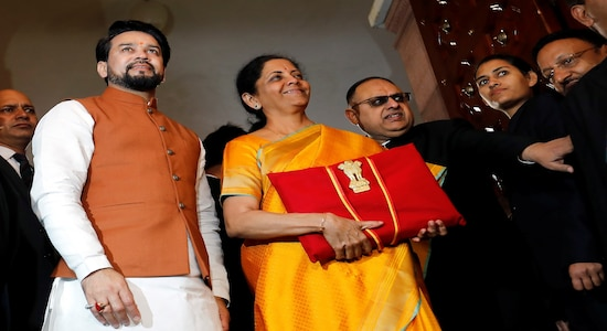Finance Minister Nirmala Sitharaman is flanked by junior Finance Minister Anurag Thakur as she arrives to present the budget in Parliament in New Delhi, India, February 1, 2020. REUTERS/Altaf Hussain