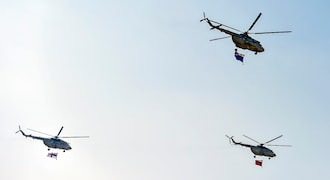 Lucknow: MI 17 V5 helicopters fly past as they rehearse for the Defence Expo 2020, in Lucknow, Sunday, Feb. 2, 2020. Prime Minister (PM) Narendra Modi is expected to inaugurate the mega event, to be held from Feb. 5 to Feb. 9.(PTI Photo/Nand Kumar) (PTI2_2_2020_000104B)