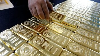 Gold holds firm above $1,800 per ounce on virus fears, weaker dollar
