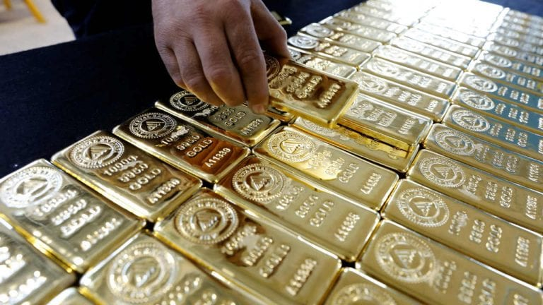 Gold price firms on safe-haven demand, but stronger dollar caps gains