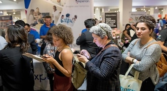 US jobless claims fall below 1 million but remain high