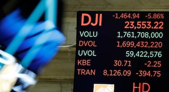 Dow cracks 30,000, a psychological boost during coronavirus pandemic