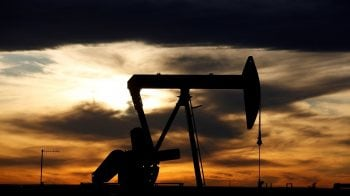 Oil firms on US stimulus hopes, Asian demand recovery