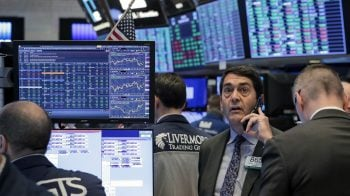 Wall Street muted with eyes on stimulus