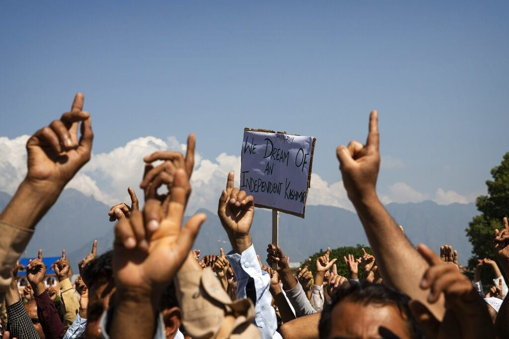 Kashmiri men shout freedom slogans during a protest against the central government's tightened grip on the disputed region, after Friday prayers on the outskirts of Srinagar, Aug. 23, 2019. (AP Photo/Dar Yasin)