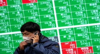 Asian stock markets tense in shadow of Evergrande and Fed