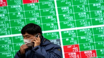 Asian stocks fall on US stimulus uncertainty