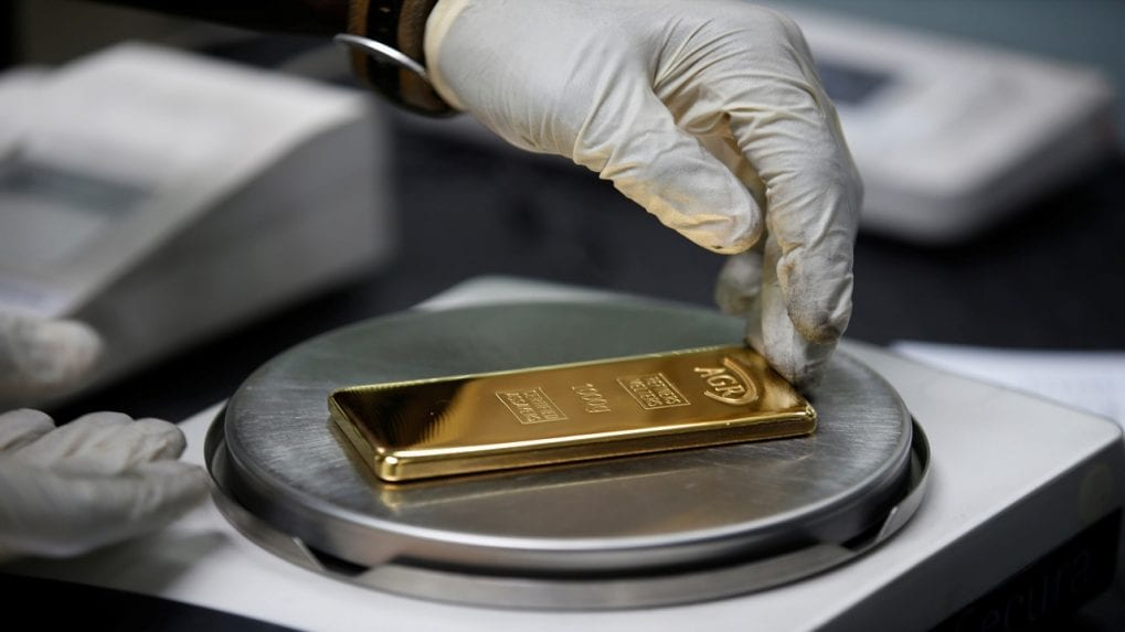 Gold holds steady, tracks dollar as election caution kicks in