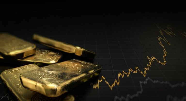 Gold prices tumble to 8-month low; fall 20% from record high