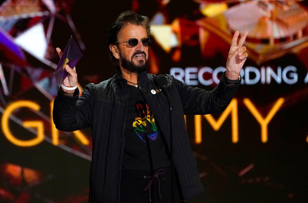 Ringo Starr gestures as he presents the award for record of the year at the 63rd annual Grammy Awards at the Los Angeles Convention Center on March 14, 2021. (AP Photo/Chris Pizzello)