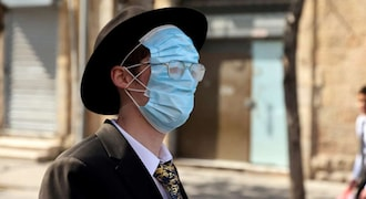 Israel brings back mask rule as new COVID-19 variant leads to fresh outbreak